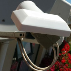 Plastic LNB cover to reduce LO frequency Drift